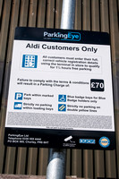 A picture of Aldi carpark and a sign from ParkingEye.